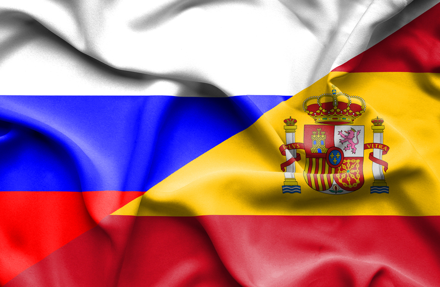 Waving flag of Spain and Russia